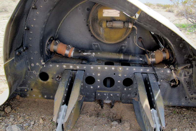 Looking into the rear section, the large tubing supplies air to the defrost/defog ducting that runs all the way round the inside of the canopy. The round item is the cockpit dump valve that opens in case of failure of the cockpit pressure regulator, the tag on it indicated that it was set at 5.4 psi.