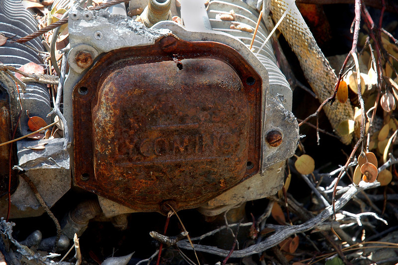 One of the valve covers. The NTSB report started that;<br /> <br /> The engine cylinder rocker covers were removed; all valves, springs, rocker arms, push rods present and appeared undamaged. The sparkplugs were removed and examined.<br /> <br /> Looks like they replaced the covers and plugs.