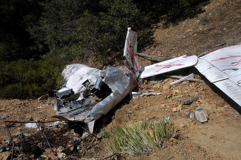 View of the remaining fuselage and tail. The NTSB report stated that;<br /> <br /> The wreckage was reduced to ash and melted metal in the cockpit and cabin area. The wings, tail, and engine were all present in their appropriate locations.