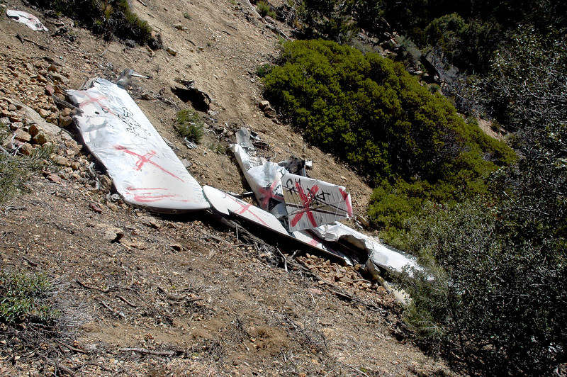 Looking back at the crash site as I start the hike back up the slope. This photo shows the angle of the slope.