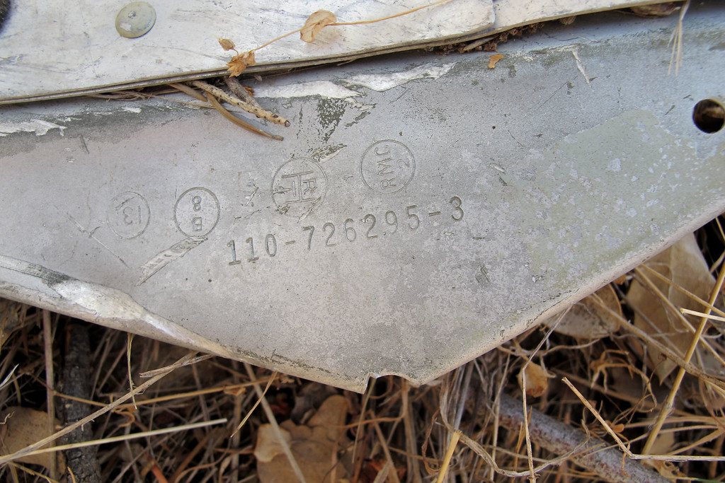 Close up of the part number and stamps. The 110 part number prefix confirms that the wreckage is from a C-119. I was pretty sure that it was the plane I was looking for by the location and the orange and black paint on some of the pieces, but it's nice to confirm it.