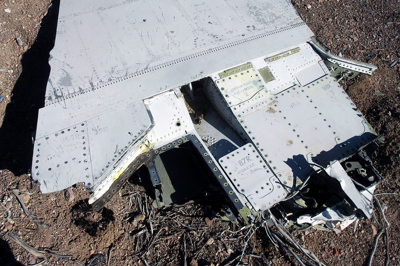 View of the danage to the flap caused by being torn off the wing.