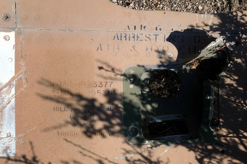 """Lettering on the same piece. I looked up the Mil Spec numbers and one is for epoxy primer and the other for camouflage paint. Also there is """"HILL AFB TOUCH UP ONLY"""" and the date Dec 20, 1976."""