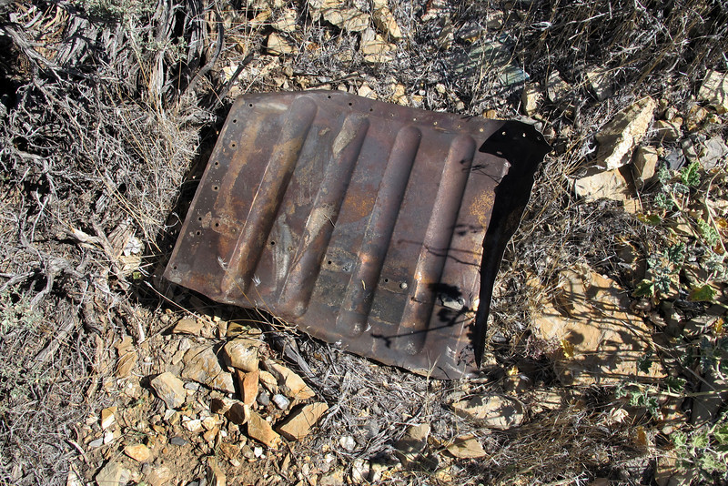 This steel part is about twelve inches square, guessing that it might be from the engine compartment.