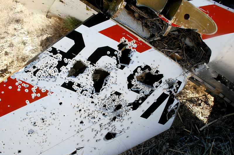 """It was shot full of holes, but could make out """"N656"""" on this side. Seems like anything left out in the desert ends up full of holes."""