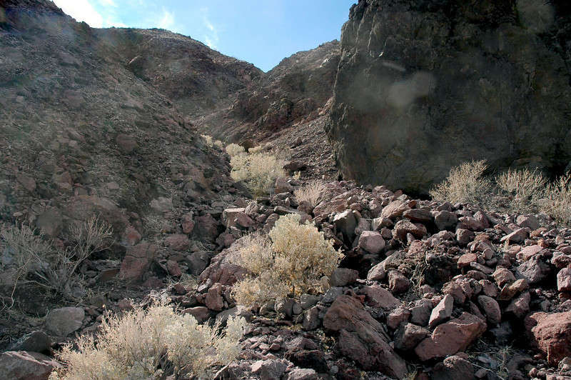 Almost to the top of the canyon, decided to climb up on a ridge to see if I could spot any more large pieces. Was finding a lot of small stuff scattered over the area.