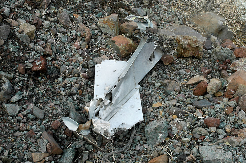 The part number indicates that it's from the KC-135, think that it might be the tail end of one of the engine pylon fairings with a piece of the lower wing skin attached.