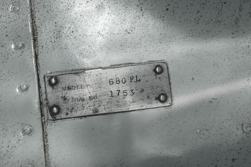 Close up of the tag with the plane's model and serial numbers.