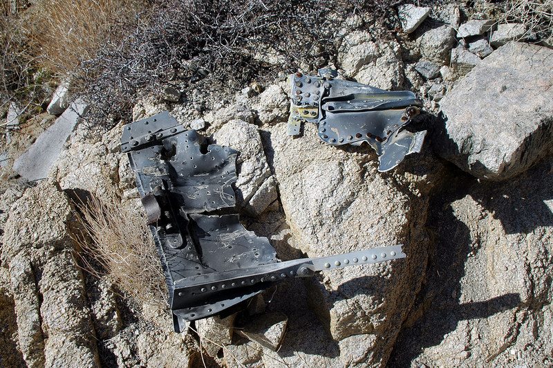 I'm not sure, but I think that these are pieces from an ejection seat.