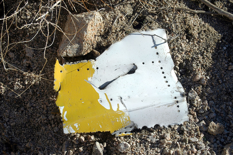 Piece of fuselage skin with the yellow paint that marked the wreckage as a known site.