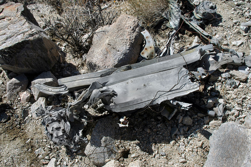 After turning it over, could tell it was a piece of the fuselage with a section of track for the sliding canopy.