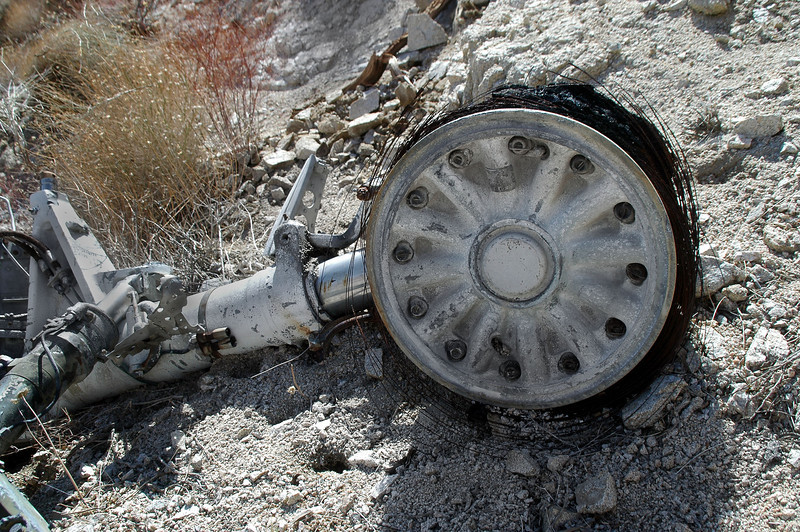The wheel with what little remains of the tire.