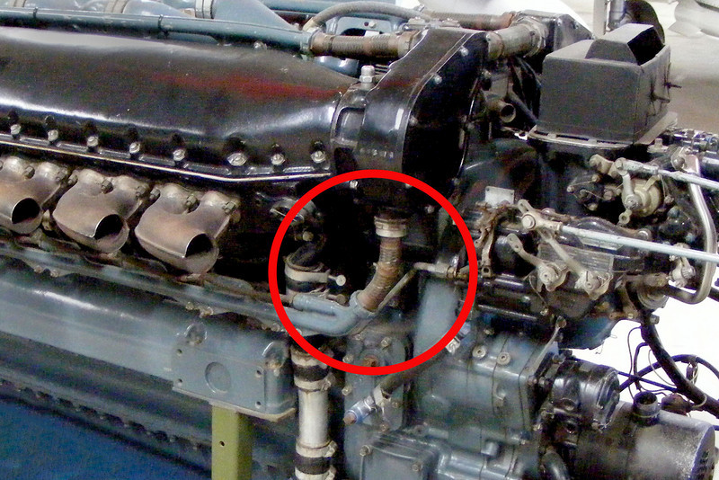 Checking the photos I had of the Allison V-1710 V12 engines, found that it was part of the conduit for the spark plug wires. Looks like one of the connectors to the cam driven magnetos.