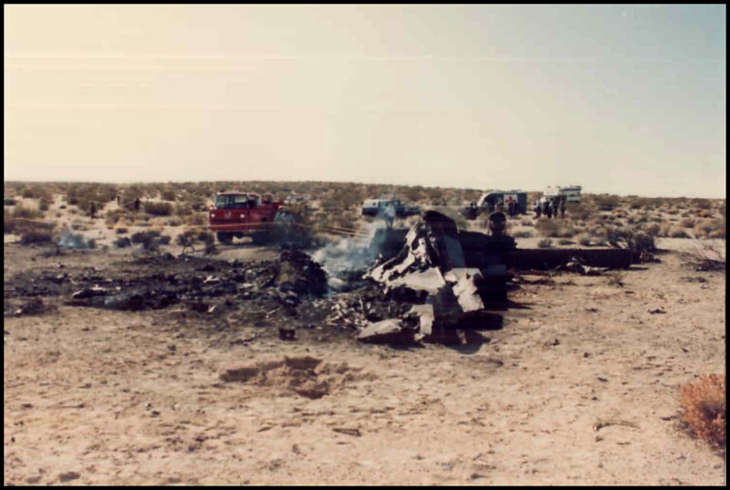 Another report photo shows the wreckage from the vicinity of the left wing tip looking to the south. A large portion the aircraft was consumed by the post crash fire.