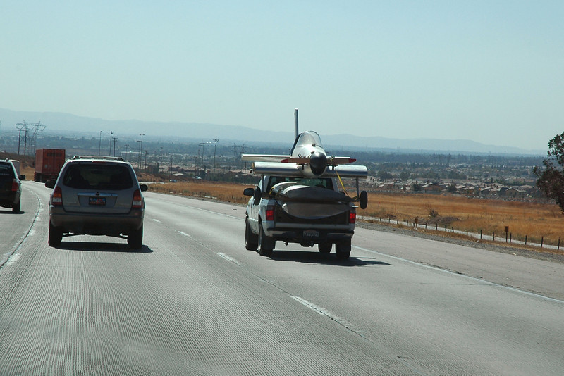 While driving home on I-15, saw this truck carrying an airplane. <br /> <br /> THE END