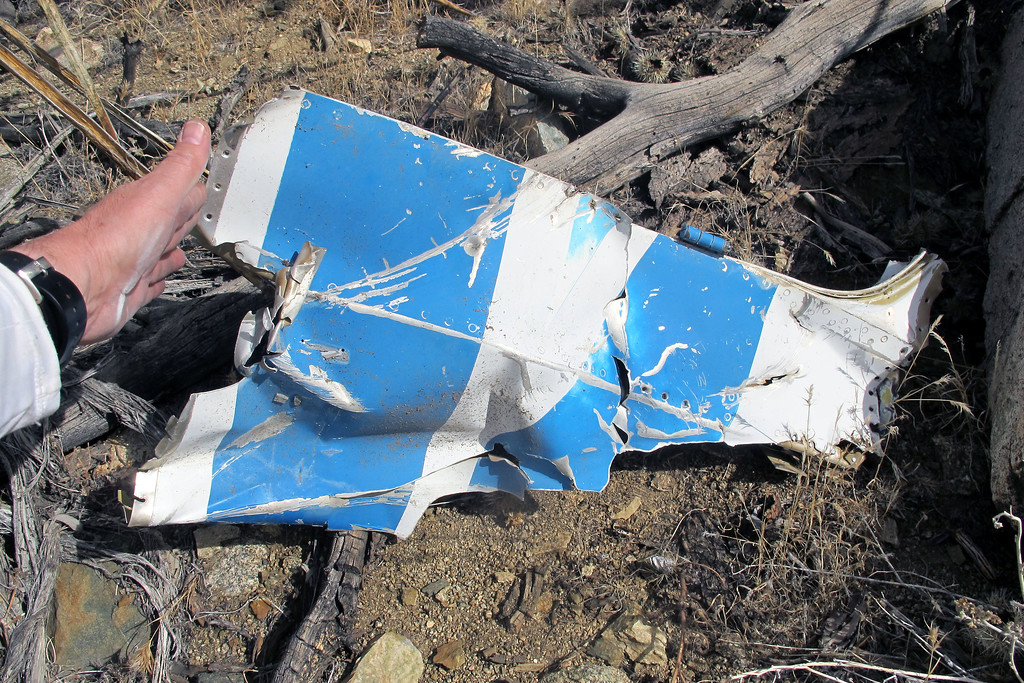 Same piece turned over. It's from the fuselage and has a hinge on it. Looks like an opening for a door.
