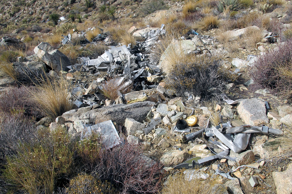 An overall view of most of the wreckage in the impact area. The wings can be seen about a hundred yards below in the upper left of the photo.