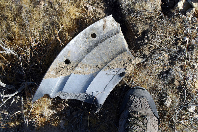 Same piece pulled out of the ground. Don't know what it is. It's made from steel, maybe a part from one of the engines? This is the largest piece I found.