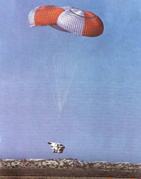 This shot shows a escape capsule about to land on it's airbags during proof of concept trials. On #74-0159 it's parachutes opened, but a failure of the explosive repositioning bolts resulted in the capsule hitting in a nose-down attitude.