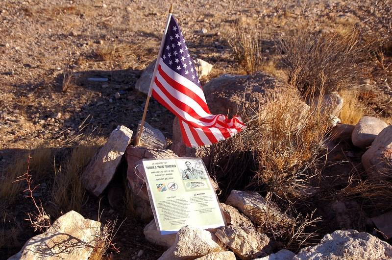 The crash site was marked with a  small American flag. It was a memorial for the pilot that was killed in the accident.