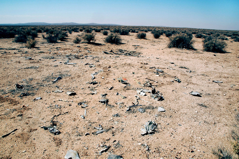 I followed the trail of wreckage to the impact crater.