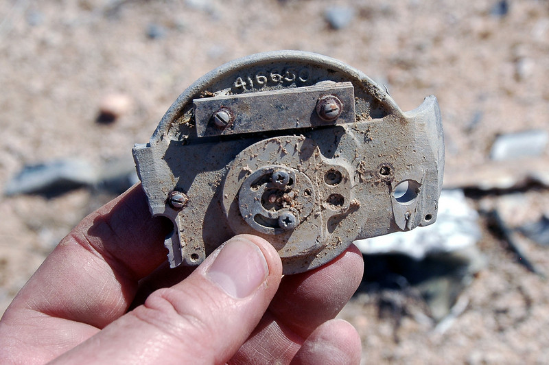 This is like the piece I found earlier, looks like it might be the backside of a flight instrument.