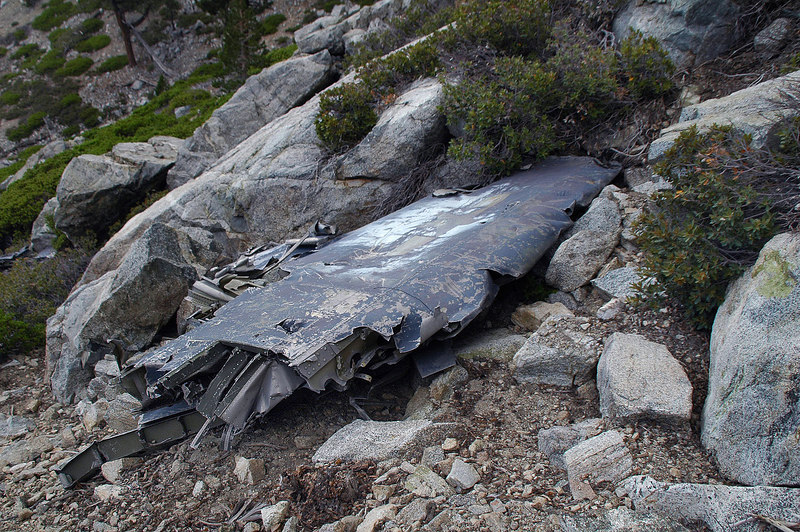 Over a drop off, I saw this wing section. Found the crash site of the second Hellcat.