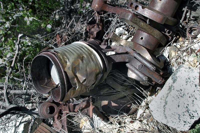 Close up of one of the cylinders and pistons with a bent connecting rod.