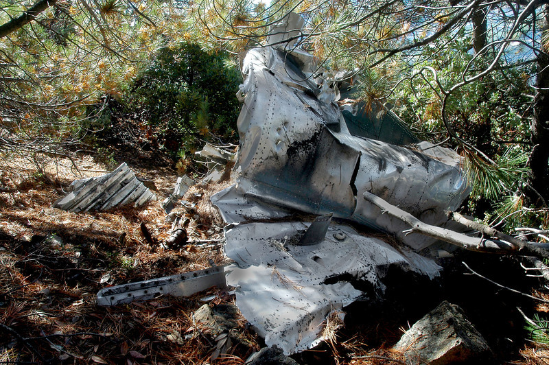 The wreckage is laying on it's left side, this view is looking at the top side.  The right side air brake is missing. At the bottom of the photo is a piece is skin from  just behind the canopy.