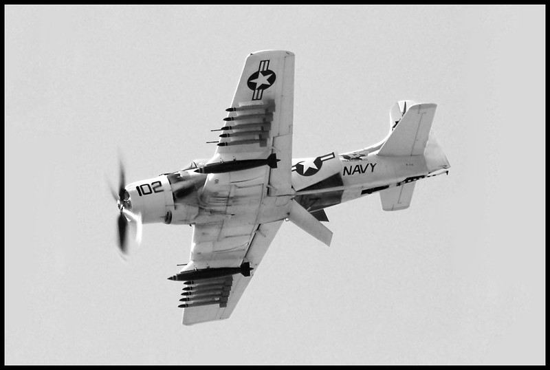 A Skyraider with all three airbrakes open.