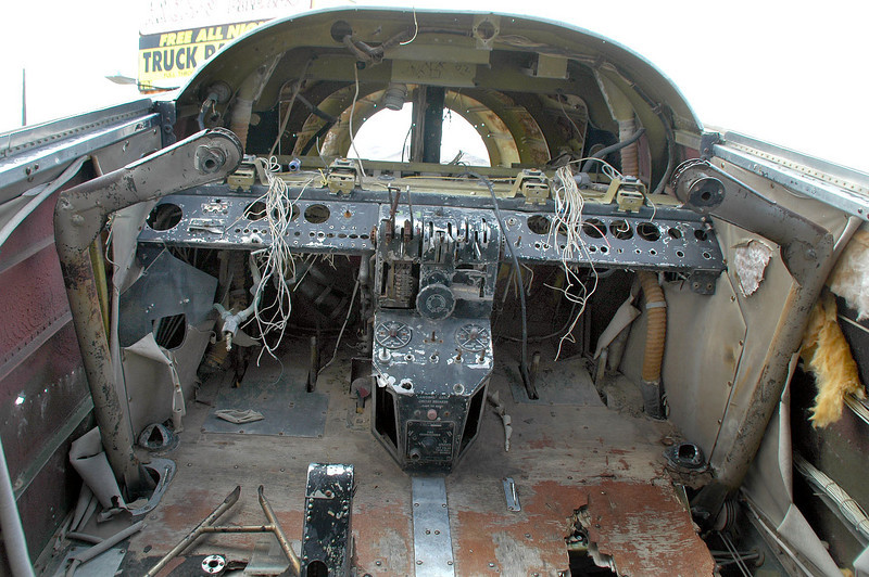 """This shot is from the C-45G N6065V at """"Angel's Ladies"""" in Beatty, Nevada. It shows the control columns. On the one on the right, you can see the pulleys and cables under the floor."""