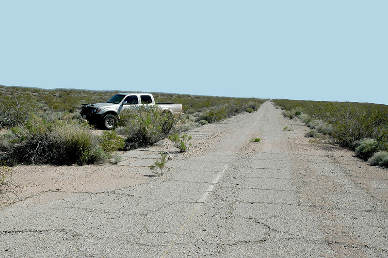 After driving on the road for awhile, Craig thought the terrain lined up pretty good with the crash site photos that he copied from report. We parked here and started searching the area. <br /> <br /> On 8/1/55, the F-86E #51-13044 call sign Eagle 3 piloted by 2nd Lt. Arthur M. Olson was on four ship fighter versus fighter simulated combat training mission. After climbing out to the applied tactics area, the flight divided into two elements to attack each other as briefed. The simulated attack began at 33,000 feet and after several maneuvers, Lt. Olson was observed initiating what appeared to be the beginning of a split S maneuver. During the pull out, there wasn't enough attitude and the aircraft struck the ground in a slight nose down wings level attitude. The aircraft disintegrated on impact killing the pilot and scattering wreckage for 1,500 feet.