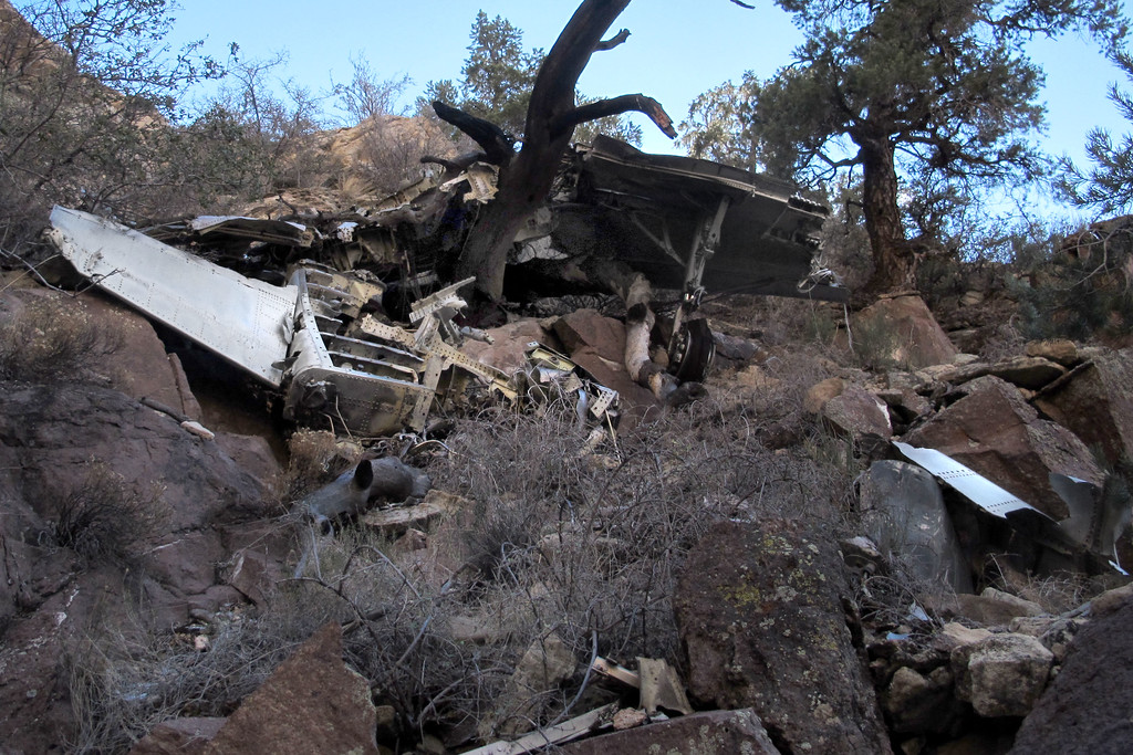 Looking up at the wing and fuselage wreckage as I start down to the tail section. Looks like the tree prevented the wreckage from falling down into the canyon.