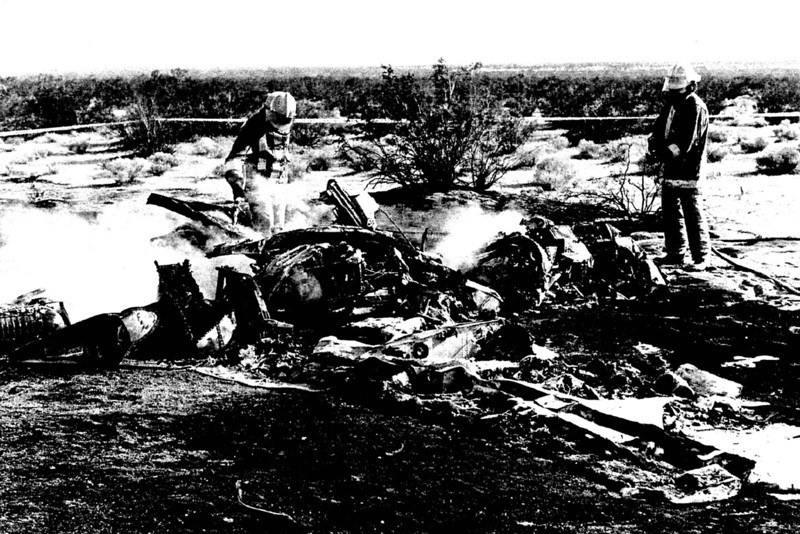 First responders at the crash site. The post crash fire consumed most of the aircraft's structure.