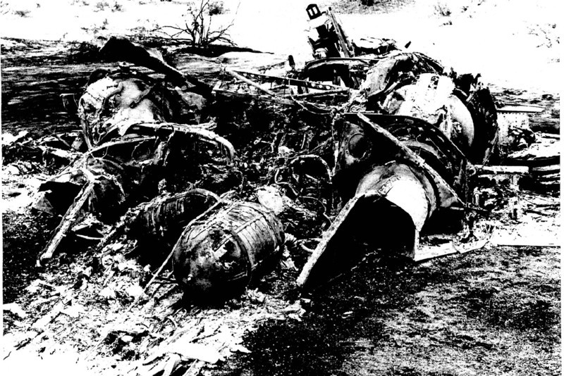 View of the wreckage from the right rear shows two oxygen tanks between the engines exhaust nozzles.  The remaining ejection seat can be seen in the cockpit.