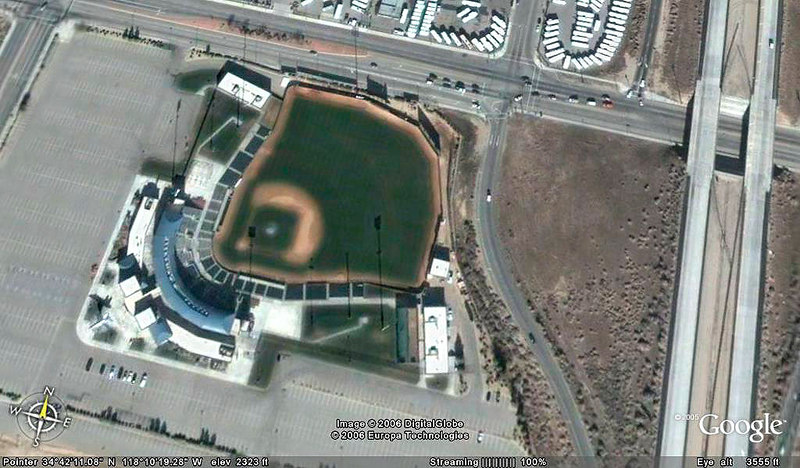 Google Earth view of the baseball stadium with the F/A-18 in the lower left. The plane's shadow shows up better than the plane does.