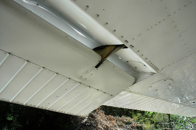 The flap was partially lowered. This looks like it was caused by the damage. The flap on the right wing was up.