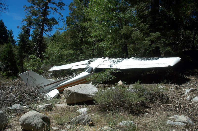 At this point all I could think about was how lucky these guys were that the plane set down with so little damage. This clear area isn't large and there's steep terrain and tall trees all around it. There's no way you can plan a landing like this.