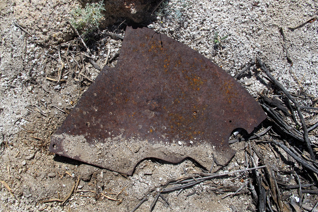 A piece of armor plate, it's about twenty inches long. Found a few more pieces, this was the largest one.