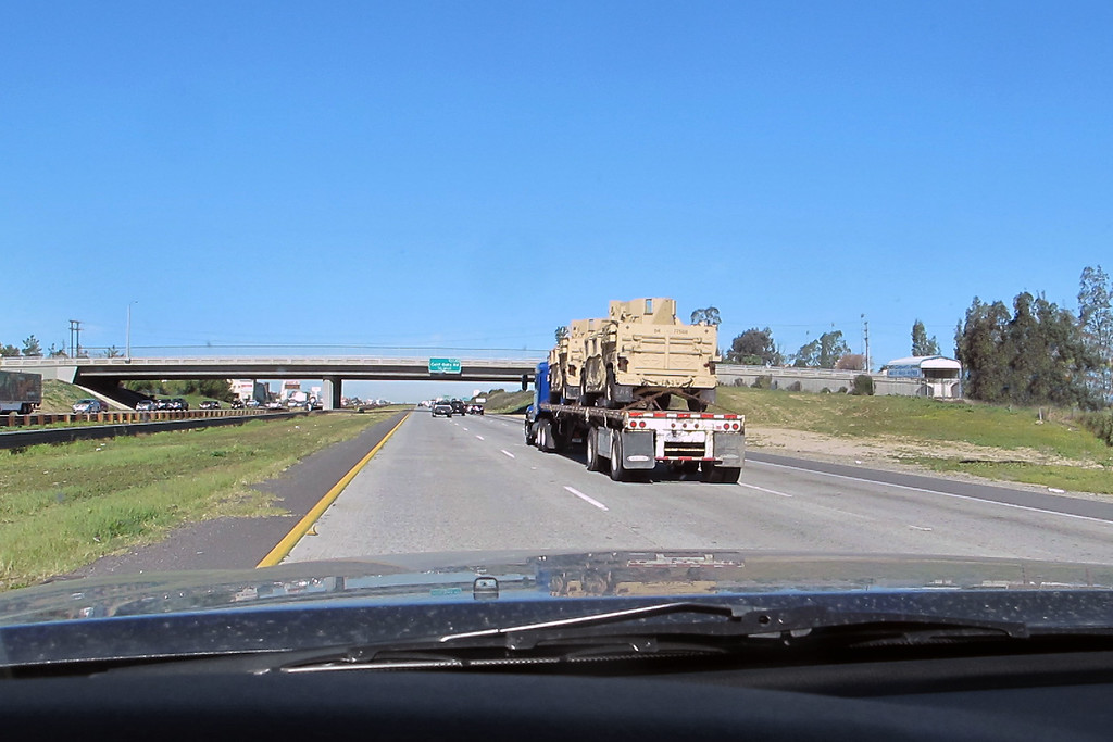On the way home, caught up to a flatbed carrying a couple of military vehicles.