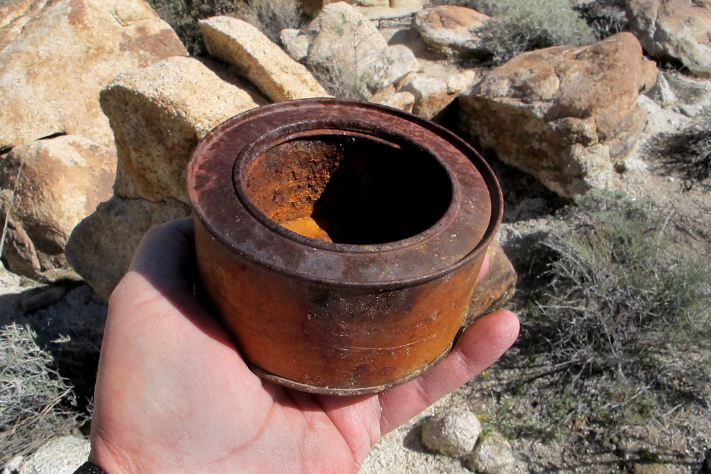Found some of these cans scattered around the crash site. They may be Sterno cans used by the aluminum scrappers who melted down most aluminum at the site during the 1950s.
