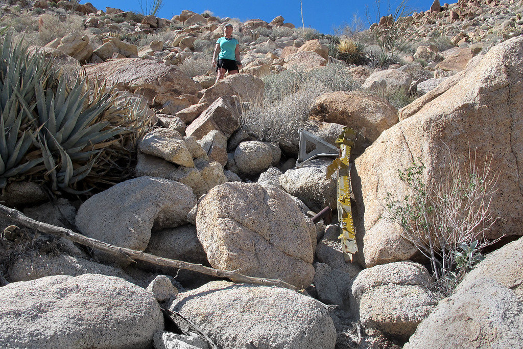 By now, we have followed the trail of wreckage up the side of a steep rocky slope.