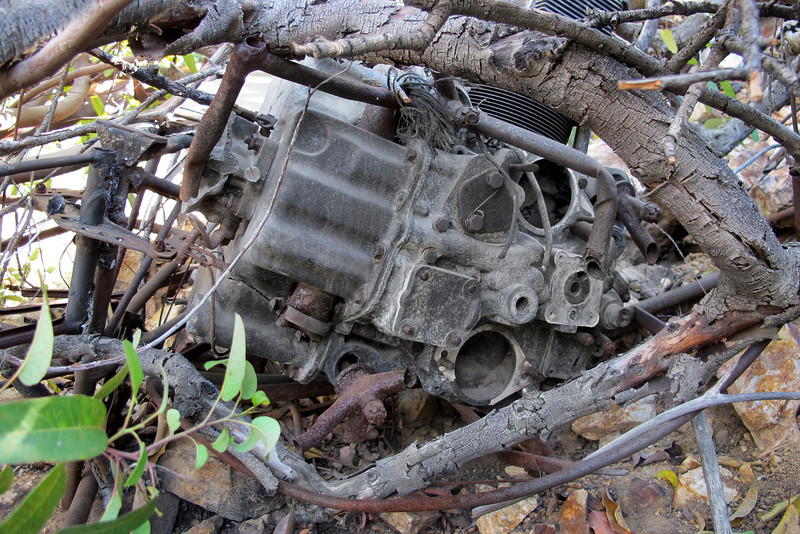 Rear end view showing the broken engine mounts. Also the remains of the carburetor mounted on the bottom of oil sump.