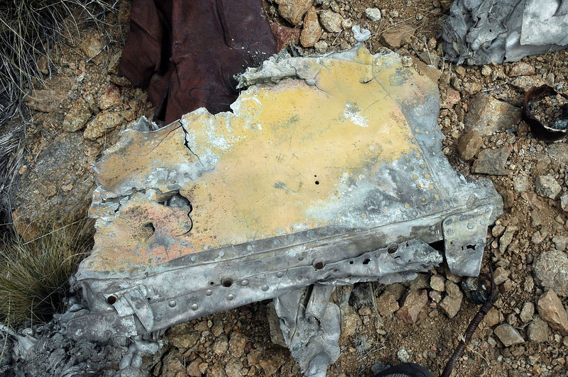 Same piece turned over. As badly as this piece was damaged by fire, I was surprised to find some paint remaining on it.