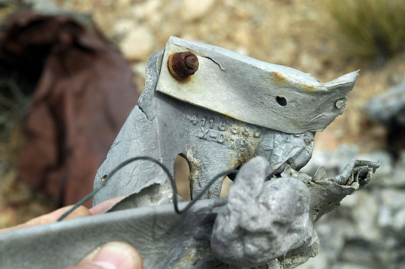 First piece I found with a part number. Most of the wreckage that remains at the site was badly damage by the post crash fire.