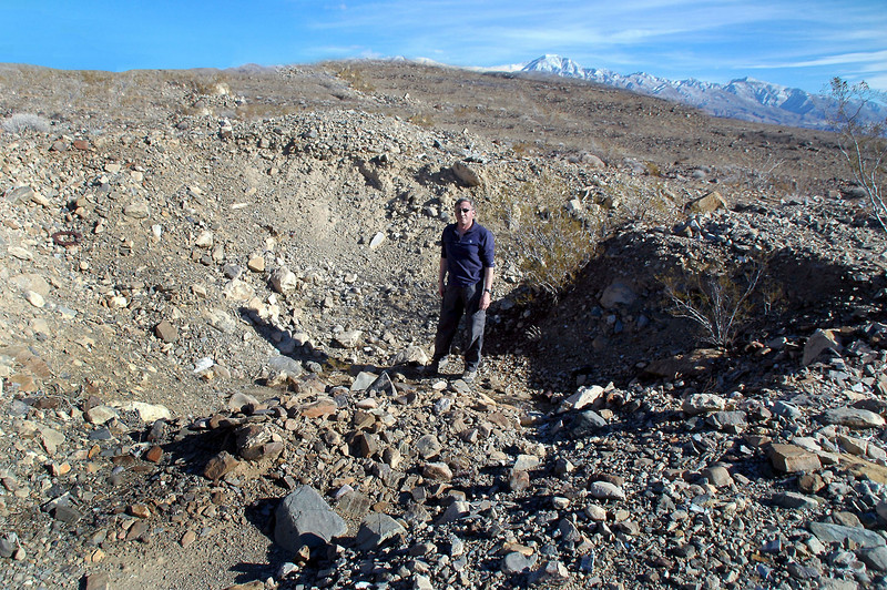 Me inside the impact crater. This is the largest crater I've seen, looks like the Thud went in steep. The debris were scattered for over a hundred yards in about a 70 degree wedge to the north radiating from the crater. Very little wreckage was outside the wedge.