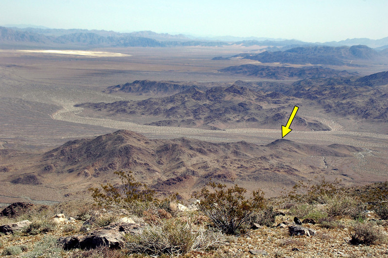 A view to the east from the top of the mountain. The arrow is pointing to the hill I hiked up the day before to try and spot the wreckage.