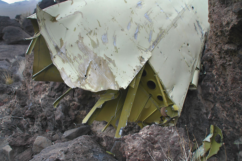 Close up showing the marks from the impact that tore the wing off the plane.
