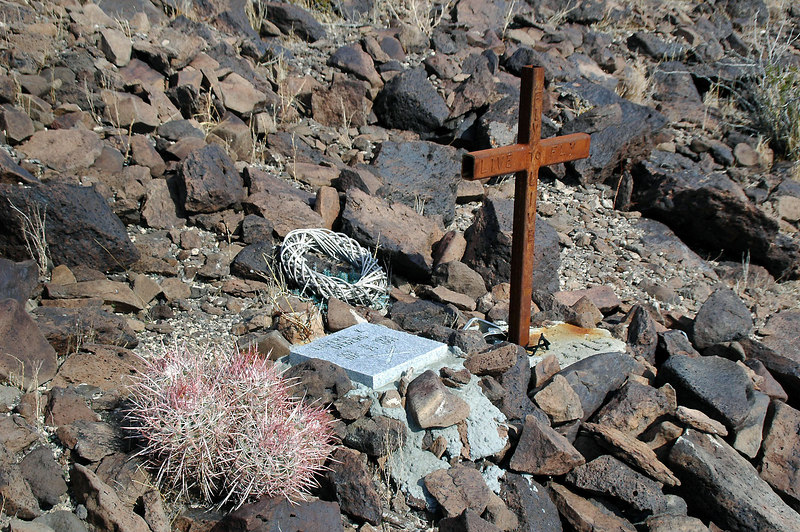 """Family and or friends built a memorial for the pilot who lost his life here 10 years ago. """"Live to fly, Fly to live"""" is writen on the cross."""