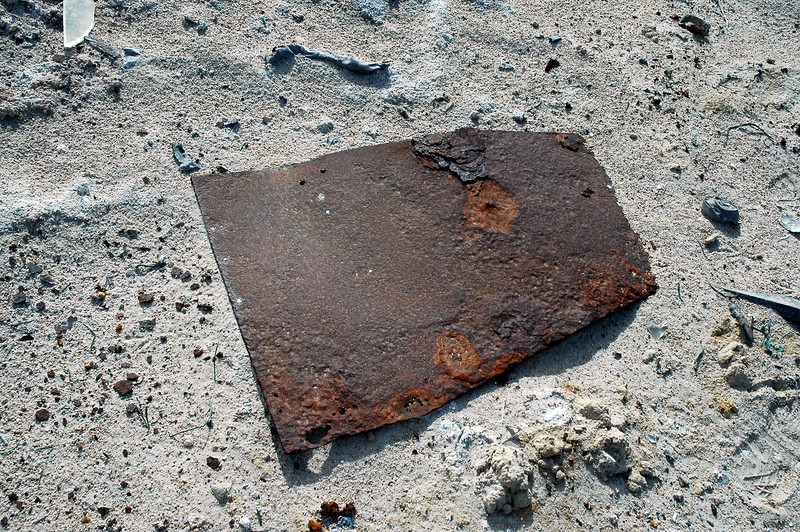 When I first saw this, thought it was a section of armor plate. It's about three feet long, but was only about 3/16 of an inch thick. Armor plate that I found at other crash sites was thicker.